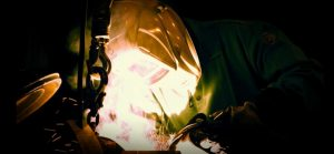A man welding steel at O'Neal Manufacturing Services.