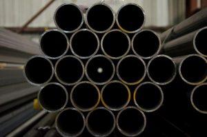 A bundle of circular steel pipes.