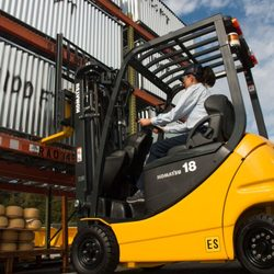 A person operating a lift truck.