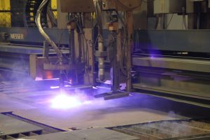 A Plasma Cutter working on a piece of steel plate.